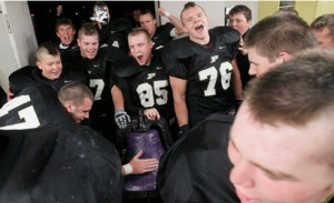 The Perrysburg football team brings the Ding Dong Bell back to their locker room in 2015 after beating Maumee 55-26. THE BLADE/KATIE RAUSCH