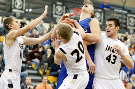 Anthony Wayne's Mark Donnal (34) battles Perrysburg's Matt Kaczinski (20) and Nate Patterson (43) for a rebound during the Jan. 8, 2013 game. The Jackets lost 71-65 in overtime.