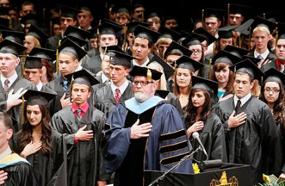 Principal Michael Short, center, recites the Pledge of Allegiance during the Perrysburg graduation ceremony at the Stranahan Theater on June 2, 2013. THE BLADE/AMY E. VOIGT