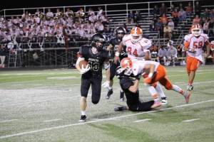 Caleb Gerken dodges a tackle Friday, October 7th against Southview. Photo credit: Chris Gulguin