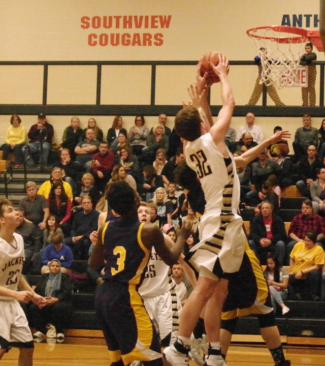 Perrysburg Junior Zach Pohlman battles for the rebound.