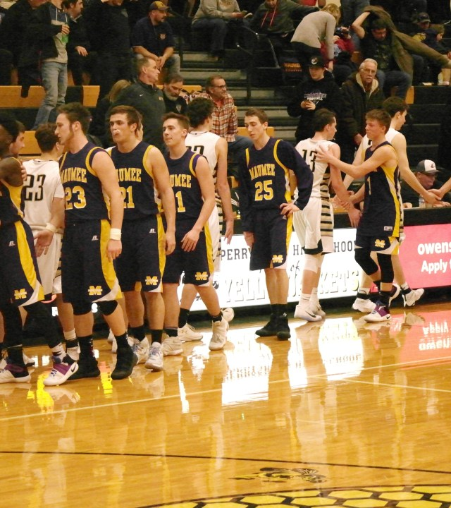 Both teams shake hands after a hard fought game. The final score was Perrysburg-79, Maumee-35.