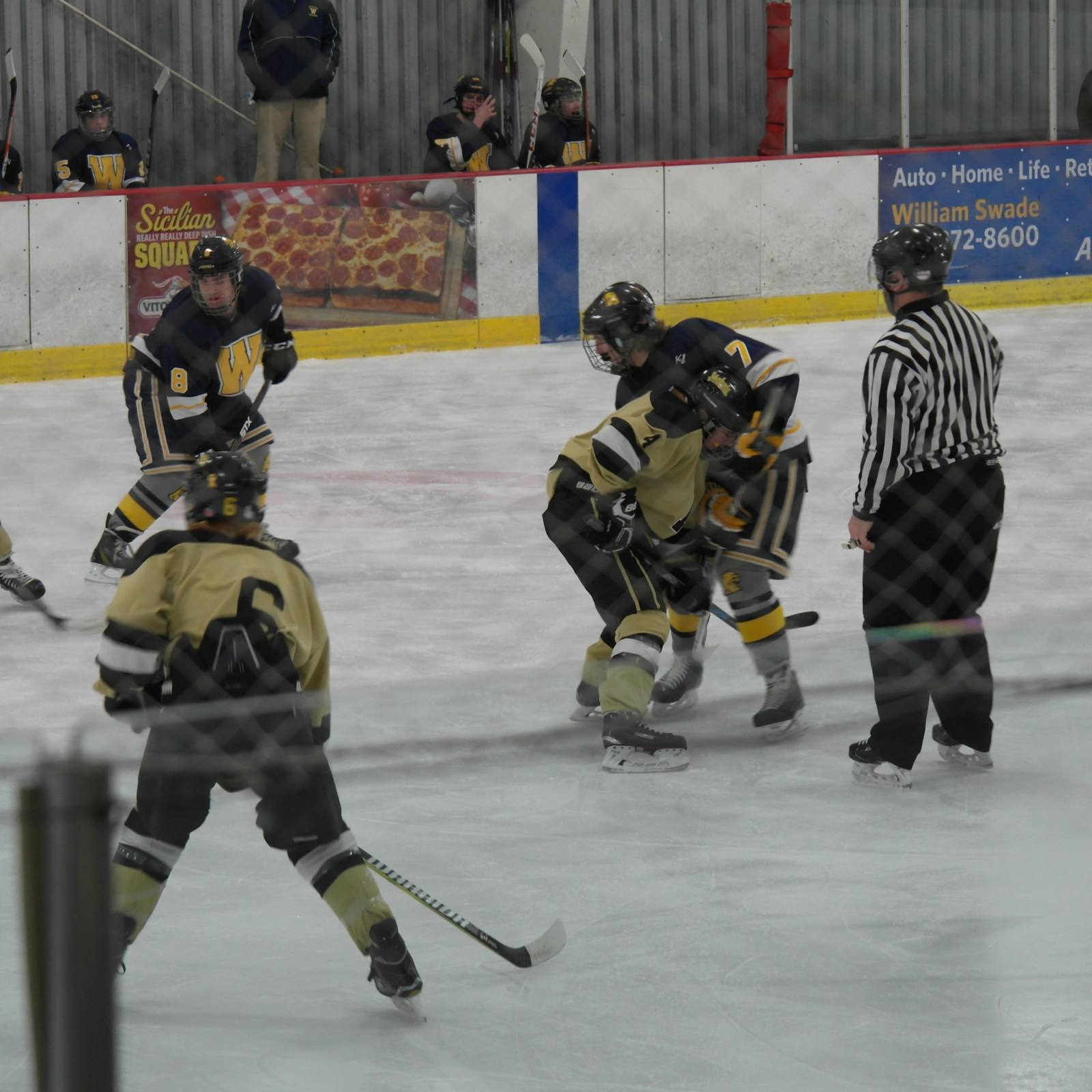 Freshman Patrick Hanley in a face off | Picture Credit: Emily Swick