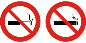 Two signs, one with a cigarette and one with an e-cigarette, both with a large red slash through them
