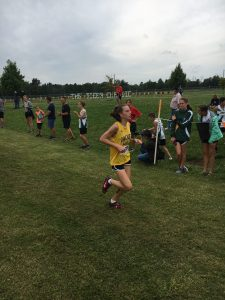 Student finishing a cross country race