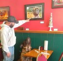 Daniel pointing out Harvey's picture on the wall at Sam B's restaurant