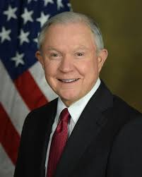 Jeff Sessions standing behind American Flag in official portrait.