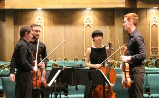 Quartet standing on stage