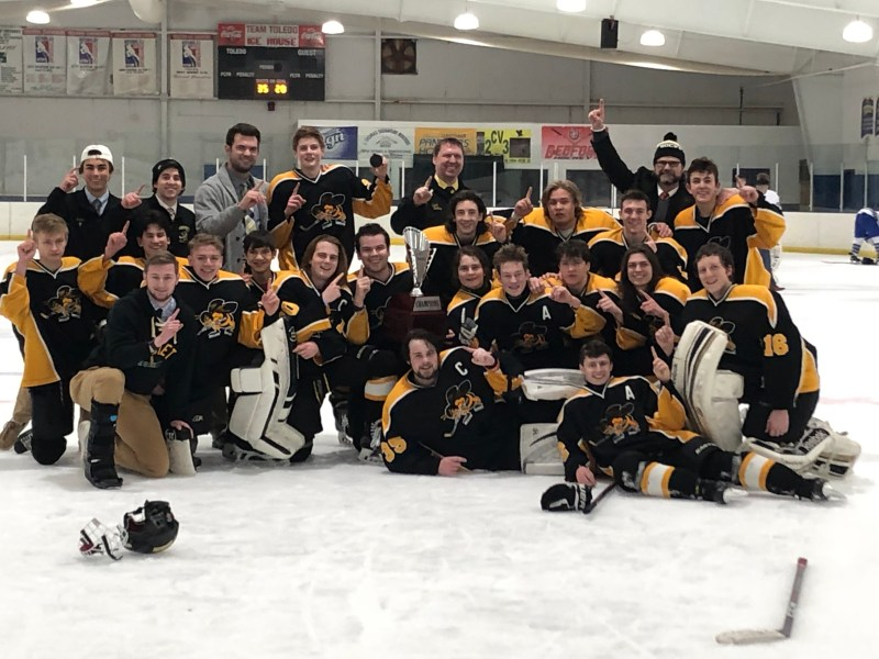 The PHS 2019 hockey team posing with the white division trophy after beating Anthony Wayne 5-4 in overtime