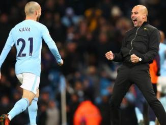 Pep Guardiola y David Silva durante un partido del Manchester City