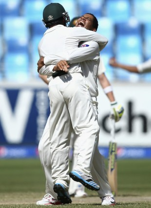 Zulfiqar Babar and Azhar Ali celebrate a wicket, Pakistan v Australia, 1st Test, Dubai, 5th day, October 26, 2014