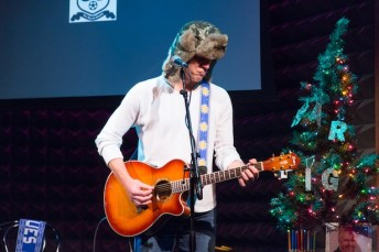 Alexi Lalas performing on stage at the Men in Blazers' Holiday Party at Joe's Pub, December 2013. (Photo by Mason Cash)