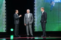 Landon Donovan (left), addresses ESPN soccer commentator Ian Darke (center) and analyst Alexi Lalas during the 2013 ESPN Upfront in New York City. (Rich Arden/ESPN Images)