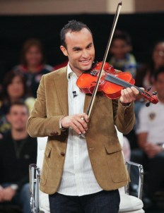 During a 2010 episode of ESPN's Homecoming with Rick Reilly, guest Landon Donovan prepares to play the violin. (Charles Baus/ESPN Images)