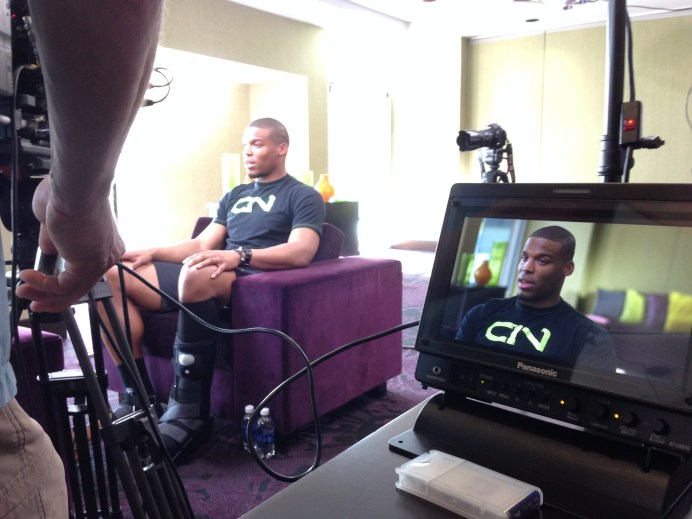 Cam Newton getting interviewed for E:60. (Martin Khodabakhshian/ESPN)