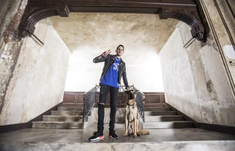 The rapper poses with man's best friend. (Grady Brannan)