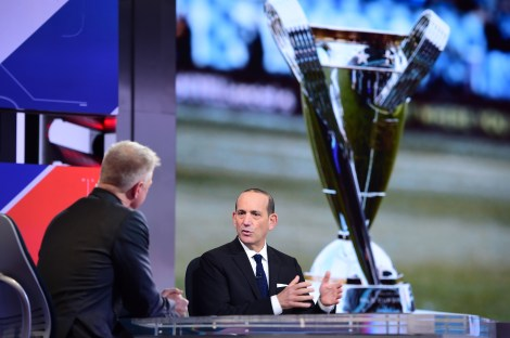 SportsCenter anchor David Lloyd (left) interviews MLS commissioner Don Garber with the MLS Cup in the foreground. (Joe Faraoni/ESPN Images)