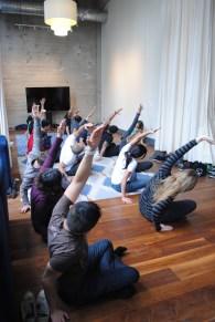 The competitors take a yoga break. (Michelle Bashaw/ESPN)