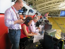 Match producer Matt Leach (standing), commentators Julie Foudy and Ian Darke preparing to call the US Women's National Team opening match in the 2011 FIFA Women's World Cup at Rudolf-Harbig-Stadion in Dresden, Germany (USA vs. North Korea). (Matt Leach/ESPN)