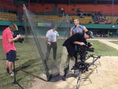 Photographers Logan Cascia (far left) and Bill Roach (in black shirt) prepare to capture Correa in a baseball stadium. (Max Brodsky/ESPN)