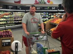 Coach Bielema at the grocery store during the filming of BEING Bret Bielema. (Photo courtesy of Mike McKinnis/JM Associates)