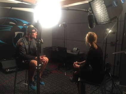 Jade McCarthy interviews Panthers tight end Greg Olsen, who will wear the badge saluting the Bell family. (Dominique Goodridge/ESPN)