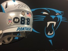 This Greg Olsen-autographed helmet will be presented to Army 1st Sgt. Russell Bell's family. Olsen will wear a similarly-decorated helmet in play on Sunday. (Dominique Goodridge/ESPN)