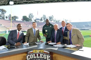 In Pasadena, Calif., at the Jan. 1, 2014 Rose Bowl: (L to R) Desmond Howard, Chris Fowler, Magic Johnson, Lee Corso, Kirk Herbstreit and Tom Rinaldi on the set of College GameDay Built by the Home Depot. (Scott Clarke/ESPN Images)