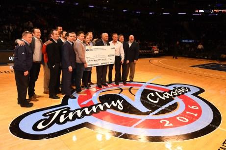 Corona presents a check to the V Foundation at the 2016 Jimmy V Men's Basketball Classic. (Joe Faraoni/ESPN Images)