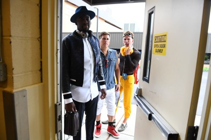 (Front to back) Draymond Green, Steve Levy and John Buccigross wait to walk the concrete carpet. (Joe Faraoni/ESPN Images)