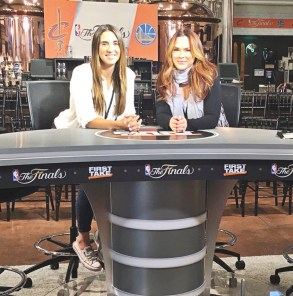 Production coordinator Elizabeth (Liz) Edwards (left) and Justine DeLuco (right) pose at the First Take desk. (Austin Corcoran/ESPN)