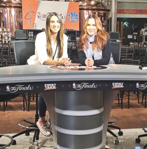 Production coordinator Elizabeth (Liz) Edwards (left) and Justine DeLuco (right) pose at the First Take desk. (Austin Corcoran/ESPN)