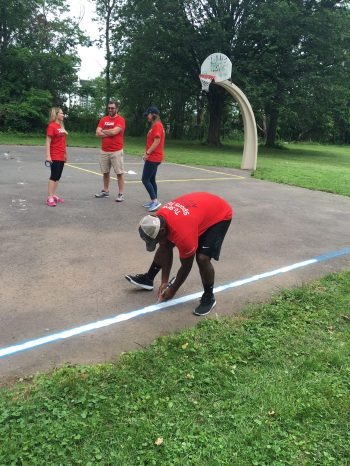 Jones paints a basketball court at Hartford's Pope Park as part of a volunteer day. (Photo courtesy of J.J. Jones/ESPN)