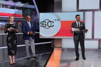 (L-R) Lindsay Czarniak, Jay Harris and Kevin Negandhi report from the set of SC:AM. (Allen Kee/ESPN Images)