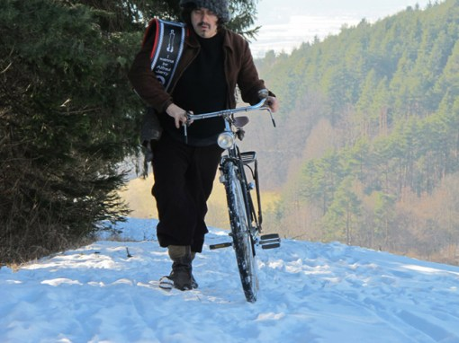 "Rainer Ganahl, ""The passion considered as an uphill bicycle race or I wanna be Alfred Jarry"", 2011, photograph, cm 50x70. Courtesy Kooio, Innsbruck, Alex Zachary, New York and the artist"