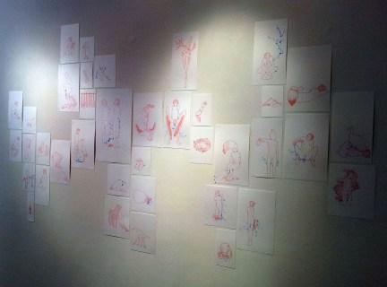 Andrea Massara, installazione a parete con foglie, china rossa, 2013