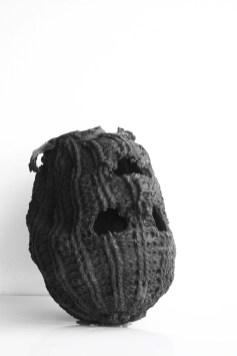 Massimiliano Pelletti, David headless, 2011, fusione in bronzo di passamontagna in lana patinata con ossidi di fegato, 33x24x28 cm