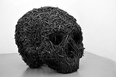 Paolo Grassino, Ciò che resta, 2013, tubo corrugato e ferro