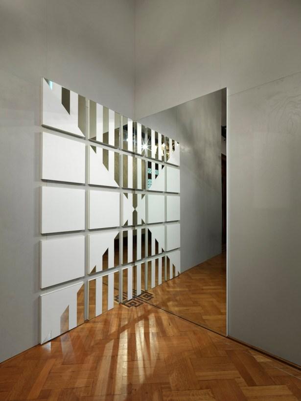Daniel Buren, A white triangle for a mirror, 2007, mirror, paint, fibreboard, white vinyl plastic, installed 252.3x252.3 cm