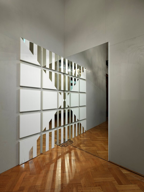 Daniel Buren, A white triangle for a mirror, 2007, mirror, paint, fibreboard, white vinyl plastic, installed 252.3x252.3 cm