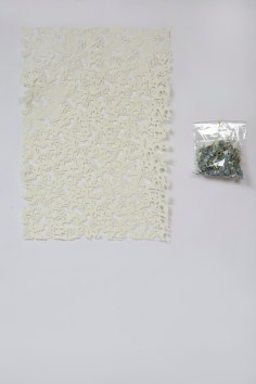 Gianluca Quaglia, Il luogo dei fiori color celeste, 2015, intagli su carta, busta di plastica, intaglio 100x70 cm, busta 40x30 cm Foto Marcella Savino