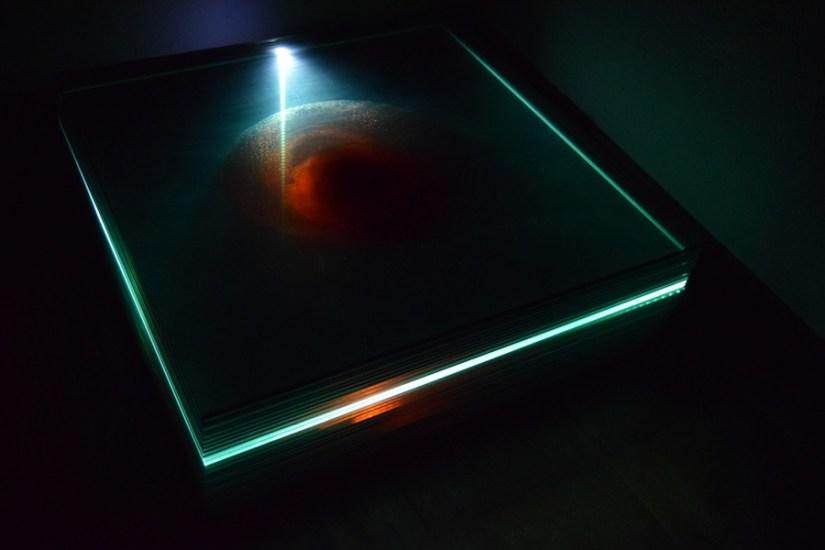 Alessandro Bartolena (Genova 1993), Bite, 2016, installazione ambientale (lastre di vetro, sangue dell'artista, sonoro: lettore multimediale, cuffie), 120x120 cm