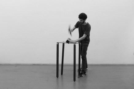 Matteo Coluccia, Voglio essere democratico, 2015, performance, cubo di ferro 10X10 cm, lastra di ferro 70X40X2 cm, piedi in ferro, 70X105 cm, mazzetta