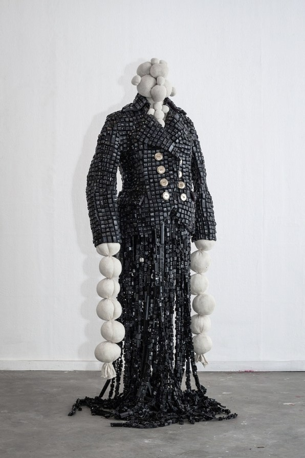 Maurice Mbikayi, La Kinoise, 2018, computer keys, fiberglass and resin, mutton cloth, knit crochet thread and found objets, 150x30x85 cm Courtesy Officine dell'Immagine, Milano