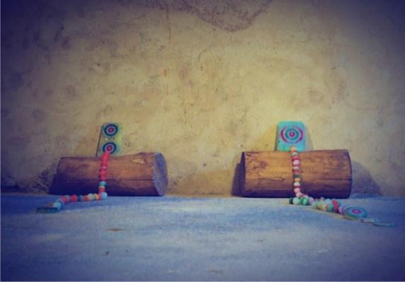Angelica Consoli, Senza titolo, 2018, paraffina, pigmenti, terra, prezzemolo, medagliette raffiguranti la Vergine Maria, carta, fiori, stoffa