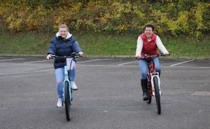 Small Business Saturday. Kayleigh and Amanda May on the electric blue Wisper 705 se and RooDog Striker ebikes
