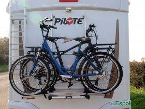 Pulse ZL 2 and Wisper 905 se electric bikes on the back of a motorhome