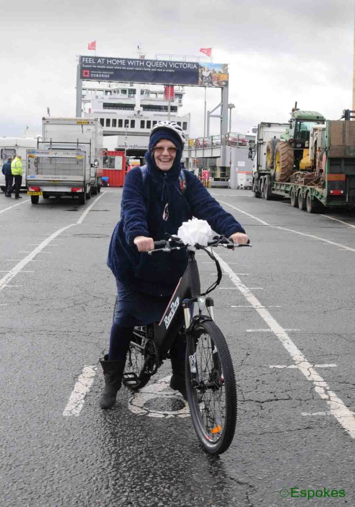 Claire Franklin of The Isle of Wight pictured collecting her RooDog Avatar step-through from the Red Funnel ferries terminal at Southampton Docks, Hampshire