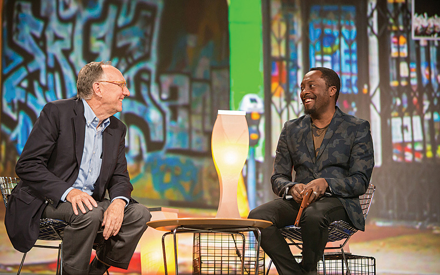 sofa ersi grinno with ottoman will i am embraces gis arcnews jack dangermond and talk about technology education inner city programs