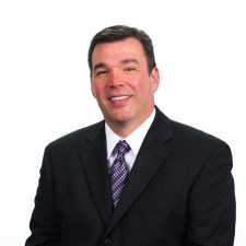 Headshot of Robert Peterson, of Education Planning Resources, in a suit.